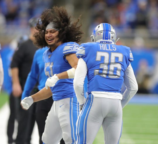 Detroit Lions running back Wes Hills celebrates his touchdown with linebacker Jahlani Tavai against the Tampa Bay Buccaneers during the second half Sunday, Dec. 15, 2019 at Ford Field.