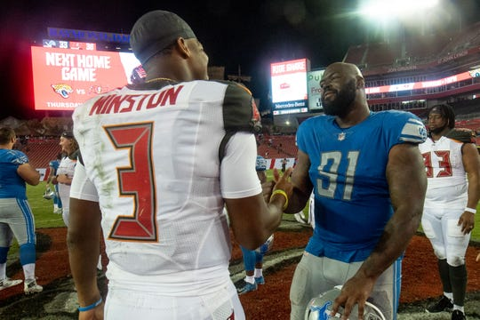 Tampa Bay Buccaneers quarterback Jameis Winston and Detroit Lions defensive tackle A'Shawn Robinson shake hands after a preseason game at Raymond James Stadium, Aug. 24, 2018.
