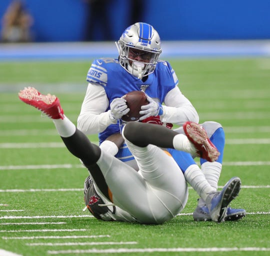 Lions running back Wes Hills is tackled by Buccaneers linebacker Jason Pierre-Paul during the first half on Sunday, Dec. 15, 2019, at Ford Field.