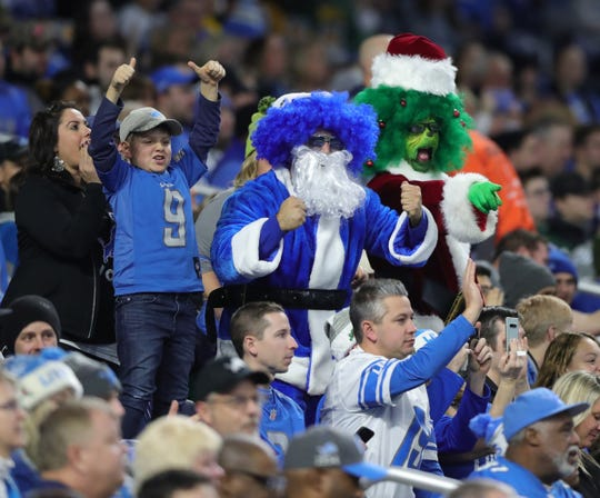 Detroit Lions fans cheer during action against the Tampa Bay Buccaneers, Sunday, Dec. 15, 2019 at Ford Field.