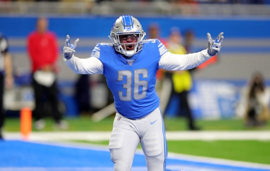 Detroit Lions running back Wes Hills celebrates his touchdown against the Tampa Bay Buccaneers during the second half Sunday, Dec. 15, 2019 at Ford Field.