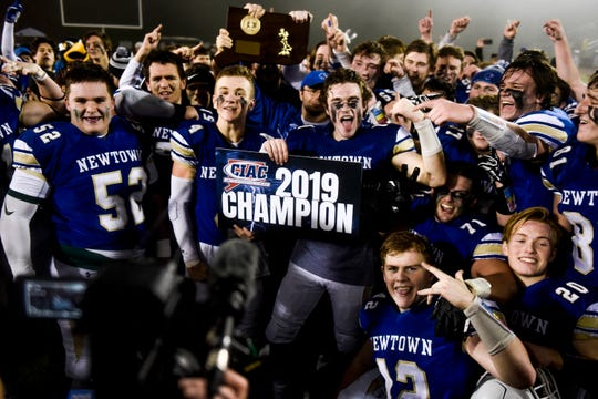 Newtown Nighthawks celebrate their win after beating the Darien Blue Wave on the final play of the Class LL state football championship at Trumbull High School Saturday, Dec. 14, 2019, in Trumbull, Conn. Newtown won 13-7.