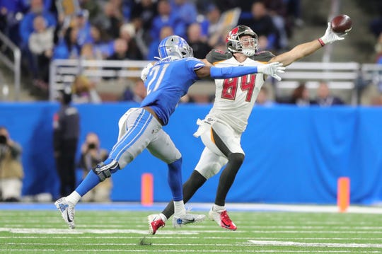 Detroit Lions defensive back Tracy Walker defends Tampa Bay Buccaneers tight end Cameron Brate during the second half Sunday, Dec. 15, 2019 at Ford Field.