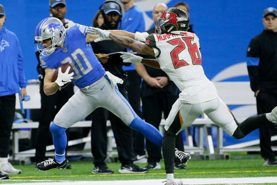 Detroit Lions wide receiver Danny Amendola is pushed out of bounds by Tampa Bay Buccaneers defensive back Sean Murphy-Bunting.