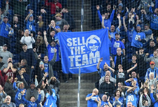 "A banner with Lions owner Martha Ford's likeness with the words ""Sell The Team"" is unveiled during a missed Tampa Bay field goal attempt in the fourth quarter on Sunday."