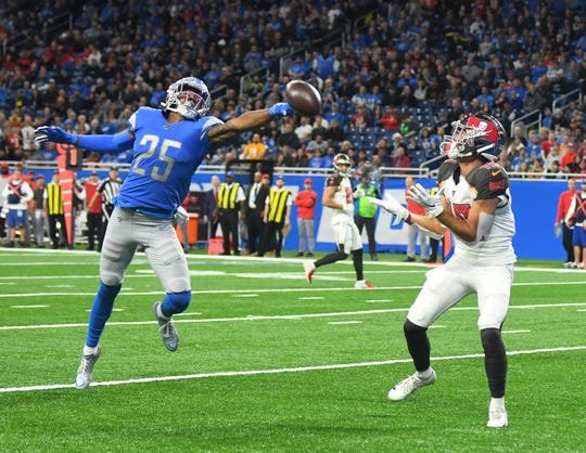 The Lions' Will Harris can't stop a touchdown pass to the Buccaneers' Scotty Miller in the first quarter.