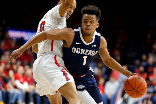 Gonzaga guard Admon Gilder drives around Arizona guard Jemarl Baker Jr. in the first half.