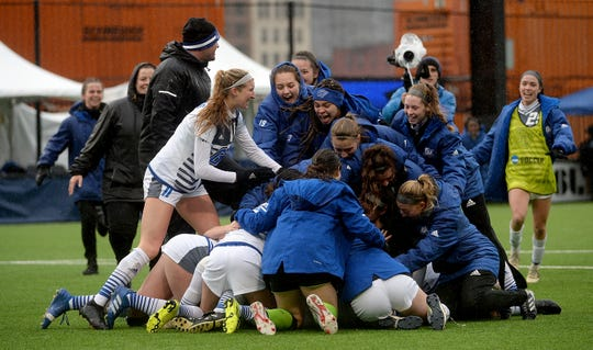 Grand Valley State women's soccer team celebrates after defeating West Washington 1-0 in double overtime Saturday to win the school's sixth Division II national title.