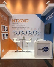 Purdue Pharma's international affiliate, Mundipharma, promotes Nyxoid, a new brand of opioid overdose reversal medication, at a medical conference in Italy.