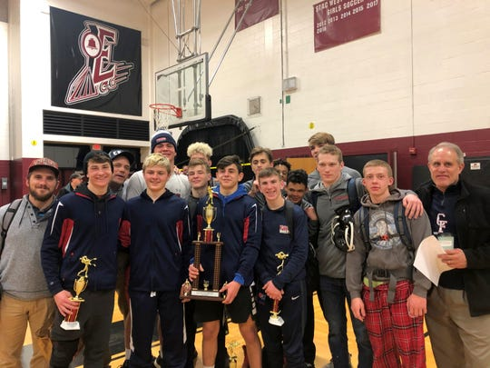 Chenango Forks celebrates with its championship hardware after taking the team title at the Dave Buck Memorial Wrestling Tournament at Elmira High School on Dec. 14, 2019.