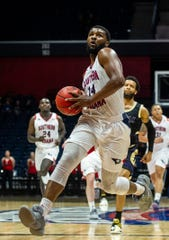 USI's Emmanuel Little (14) takes the ball across the court to dunk at the USI vs. Lincoln game at the Screaming Eagles Arena in Evansville, Sunday, Dec. 15, 2019.