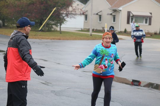 On Saturday, the Village of Gibsonburg hosted its annual Ugly Christmas Sweater 5K Run and Walk at Hilfiker Elementary School, garnering several tables worth of food and toys to be donated to charity from the estimated 100 or so participants.
