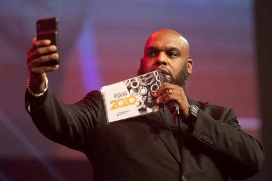 Pastor John Gray takes a video of the audience during the Vision 2020 event at Relentless Church Sunday, Dec. 15, 2019.