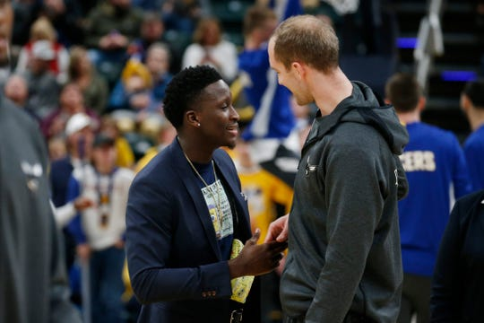Dec 15, 2019; Indianapolis, IN, USA; Indiana Pacers guard Victor Oladipo and Charlotte Hornets center Cody Zeller who both played college basketball together at Indiana University shake hands before the game at Bankers Life Fieldhouse.
