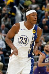 Dec 15, 2019; Indianapolis, IN, USA; Indiana Pacers center Myles Turner (33) reacts to making a three point shot against the Charlotte Hornets during the first quarter at Bankers Life Fieldhouse.