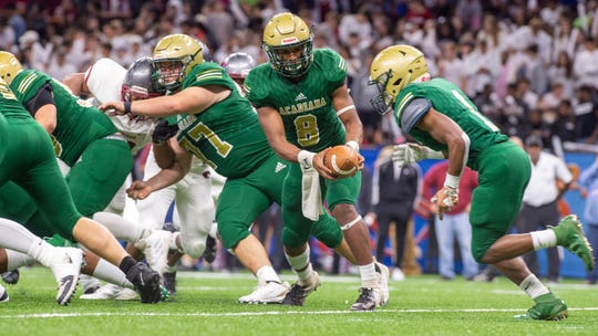Keontae Williams hands off to runningback Dillan Monette as The Acadiana Wreckin Rams take on the Destrehan Wildcats in the State Div 5A Championship game. Saturday, Dec. 14, 2019.
