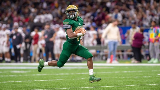 Dillan Monette makes a catch to score a touchdown as The Acadiana Wreckin Rams take on the Destrehan Wildcats in the State Div 5A Championship game. Saturday, Dec. 14, 2019.