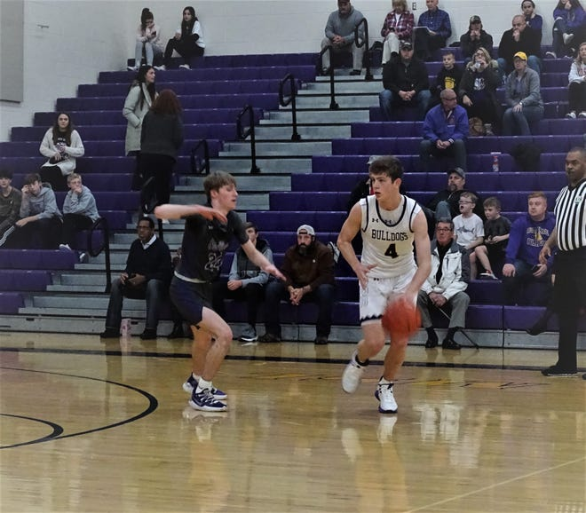 Bloom-Carroll sophomore Evan Dozer dribbles the ball against DeSales' Kobe Righter during the Bulldogs' 61-45 nonconference loss Saturday night.