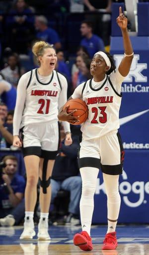 Louisville's Jazmine Jones (#23) and Kylee Shook celebrate after beating Kentucky on Dec. 15, 2019.