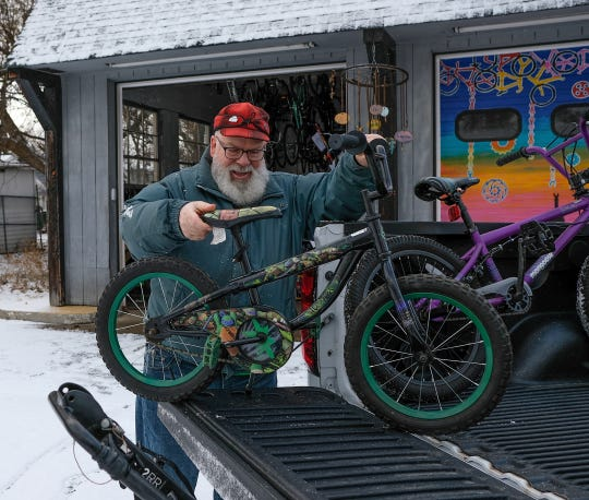 Volunteer Mike Fila fills his truck with bicycles to be given away Sunday, Dec. 15, 2019.