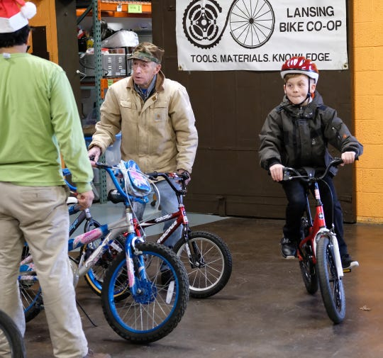 Atticus Slee-Janski, 9, gives his bike a test ride at the annual Lansing Bike Co-op's Bike Giveaway at the Allen Neighborhood Center, Sunday, Dec. 15, 2019.