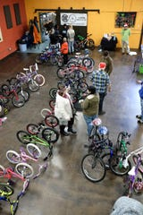 The Lansing Bike Co-op had 55 bikes to be given away at their annual event at the Allen Neighborhood Center Sunday, Dec. 15, 2019.