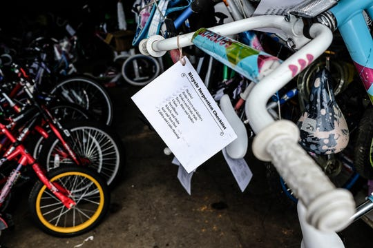 A check-list is on the bikes to be given away at the annual event Sunday, Dec. 15, 2019.