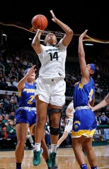 Michigan State's Taiyier Parks (14) shoots against Morehead State's Ellie Johnson, left, and Tomiyah Alford, right, Sunday, Dec. 15, 2019, in Lansing, Mich. MSU won 93-48.