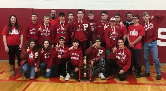 Coach Jeremiah Balkin (back row, far left) and his Plymouth Big Red won the Arcadia Invitational on Saturday, giving the wrestling team two titles in two weeks.