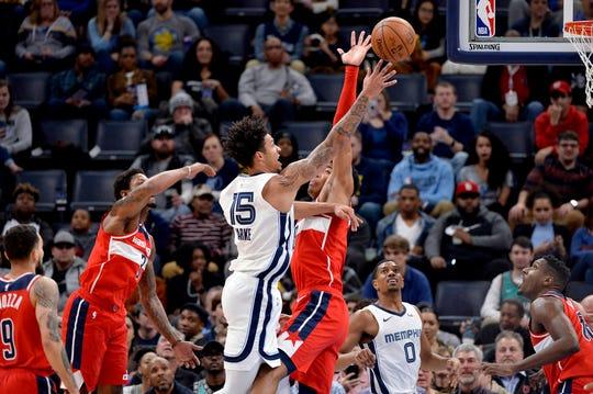 Memphis Grizzlies forward Brandon Clarke (15) shoots against Washington Wizards forward Rui Hachimura in the first half Saturday, Dec. 14, 2019, in Memphis, Tenn.