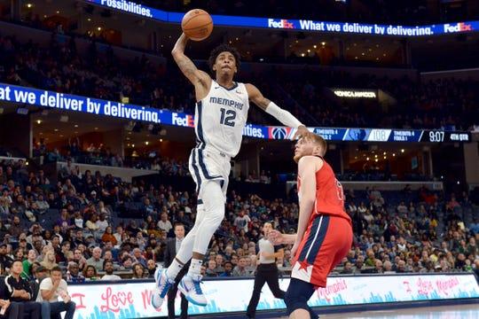 Memphis Grizzlies guard Ja Morant (12) shoots against Washington Wizards forward Davis Bertans in the second half Saturday, Dec. 14, 2019, in Memphis, Tenn.