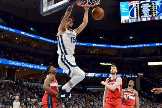 Memphis Grizzlies forward Brandon Clarke (15) dunks the ball in the second half of an NBA basketball game against the Washington Wizards Saturday, Dec. 14, 2019, in Memphis, Tenn. (AP Photo/Brandon Dill)
