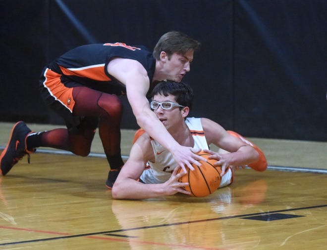 Viola's Gabe Baird dives for a loose ball ahead of Bradford's Logan Steele during the Longhorns' 76-73 victory over Bradford on Saturday.