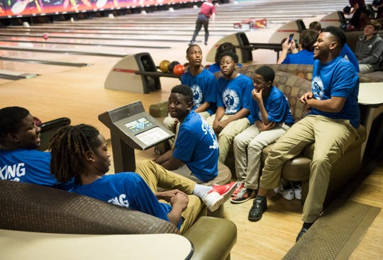 Lanier's Andre Porch jokes with his fellow bowlers during a meet at Bama Lanes in Montgomery, Ala., on Thursday, Dec. 12, 2019.
