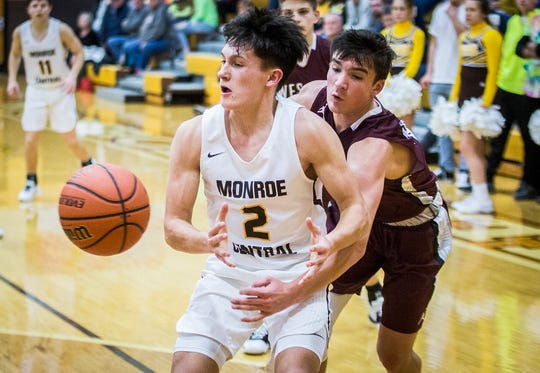 FILE -- Wes-Del's Zack Todd pokes the ball loose during their game at Monroe Central High School Saturday, Dec. 14, 2019.
