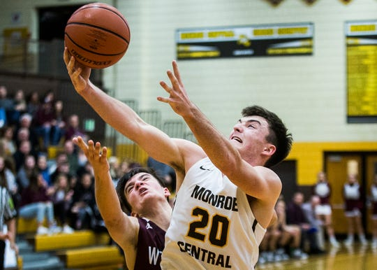 FILE -- Monroe Central's Logan Patterson shoots past Wes-Del's defense during their game at Monroe Central High School Saturday, Dec. 14, 2019.