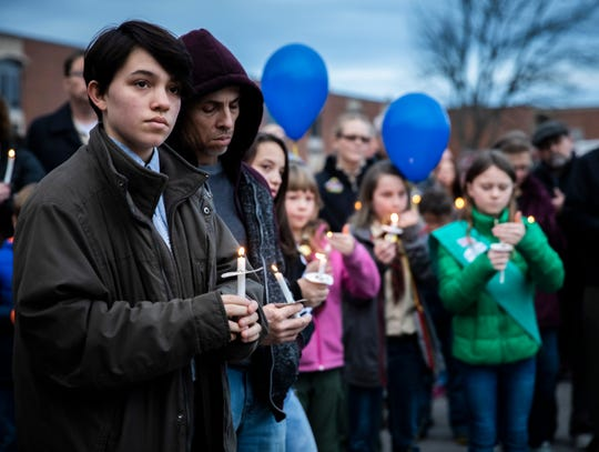 Members of the comminity attend a vigil held for Rowan Frensley at Mt. Juliet Middle School Sunday, December 15, 2019.