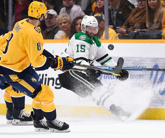 Nashville Predators center Kyle Turris (8) battle for the puck with Dallas Stars left wing Blake Comeau (15) during the second period at Bridgestone Arena on Saturday.