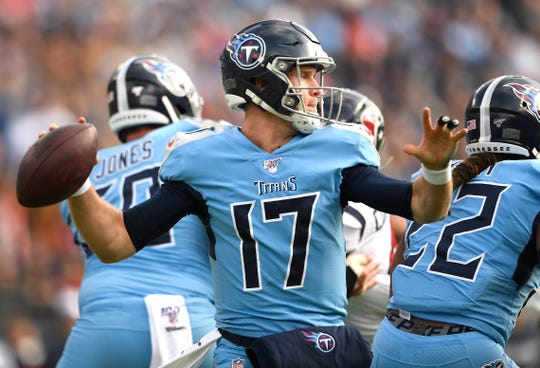 Tennessee Titans quarterback Ryan Tannehill (17) looks for receivers downfield during the first quarter at Nissan Stadium in Nashville, Tenn., Sunday, Dec. 15, 2019.