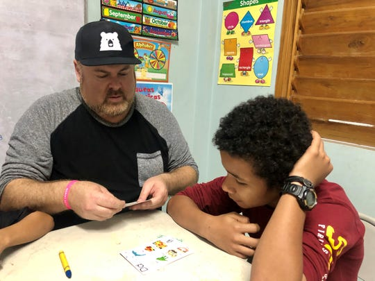 Shane Tarleton and Luis practice English in the classroom at the orphanage.