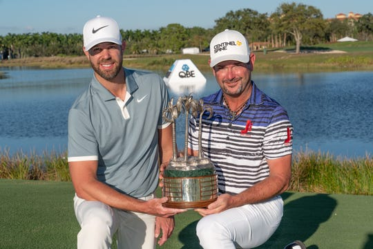 Kevin Tway, left, and Rory Sabbatini pose with the trophy after winning the QBE Shootout on Sunday, Dec. 15, 2019.