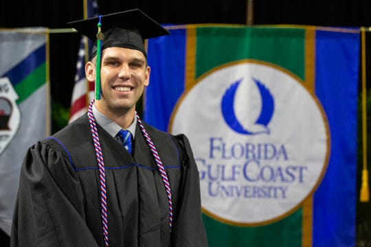 Jacob Fricke poses for a portrait before the commencement ceremony Sunday, Dec. 15, 2019, at Alico Arena of Florida Gulf Coast University in Estero.