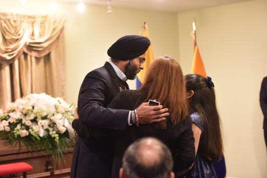 Memorial service in Paterson on Saturday, Dec. 14, 2019 for Douglas Miguel Rodriguez Barzola, who was killed in the Jersey City shooting on Tuesday. New Jersey Attorney General, Gurbir Grewal hugs Rodriguez's wife, Martha Freire, center, and daughter, Amy.