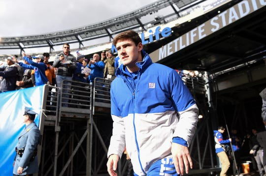 New York Giants quarterback Daniel Jones runs onto the field for pregame warmups, but will not play against the Miami Dolphins on Sunday, Dec. 15, 2019, in East Rutherford.