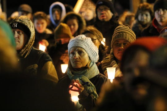 Hundreds filled Ridge Rd. just outside Queen of Peace Church, some held candles while some had trouble holding back tears in North Arlington, Sunday, December 15, 2019. They gathered to remember Jersey City Detective Joseph Seals, who was killed on Tuesday.