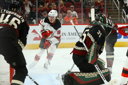 New Jersey Devils center Jesper Boqvist (90) scores a goal against Arizona Coyotes goaltender Darcy Kuemper (35) as Coyotes defenseman Oliver Ekman-Larsson, right, and Coyotes defenseman Ilya Lyubushkin (46) look on during the first period of an NHL hockey game, Saturday, Dec. 14, 2019 in Glendale, Ariz.