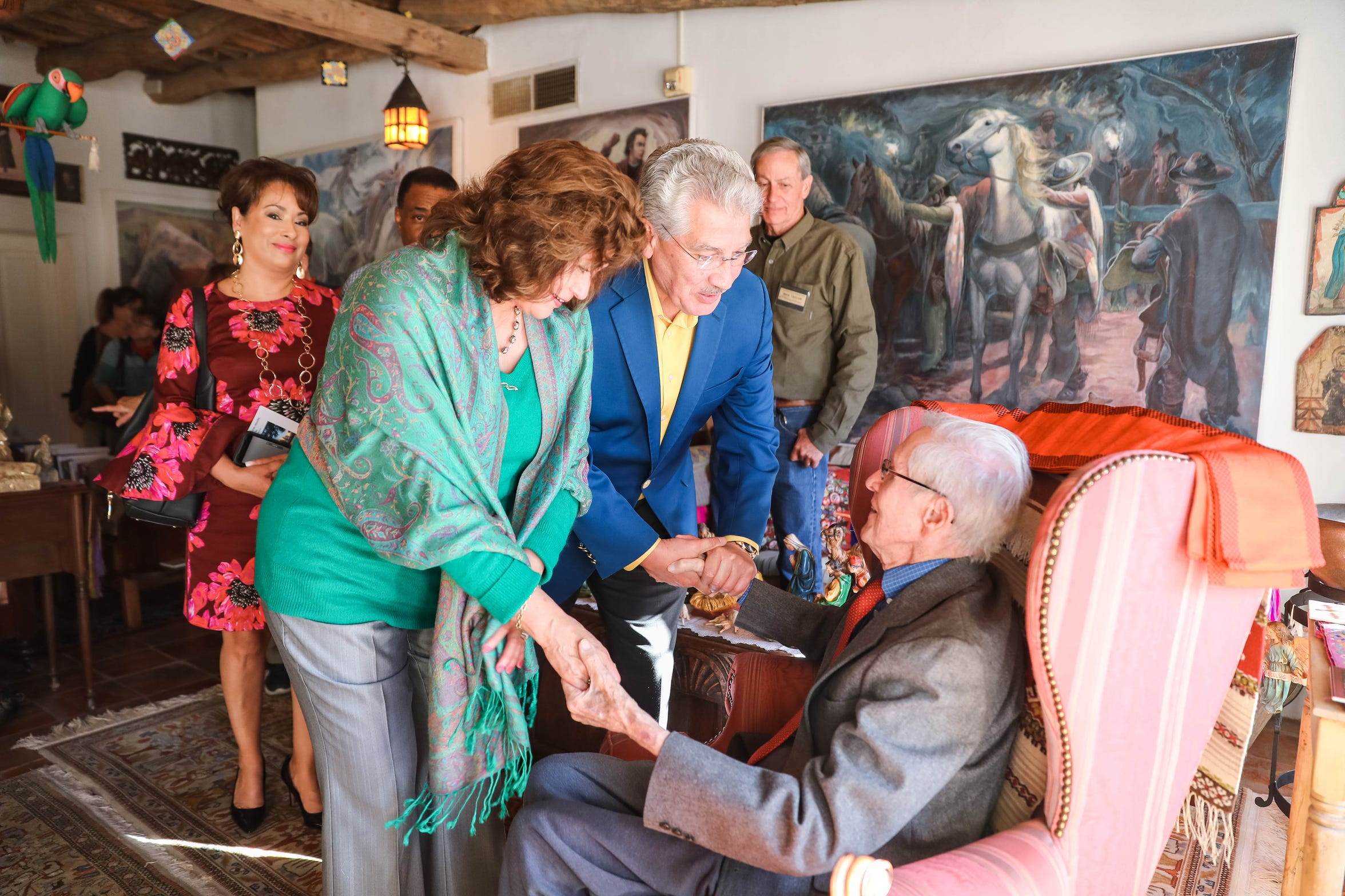 J. Paul Taylor visits with guests in his home in Mesilla on Sunday, Dec. 15, 2019.