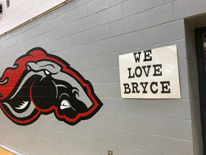 """The """"We Love Bryce"""" sign that hung right by the Novi bench."""