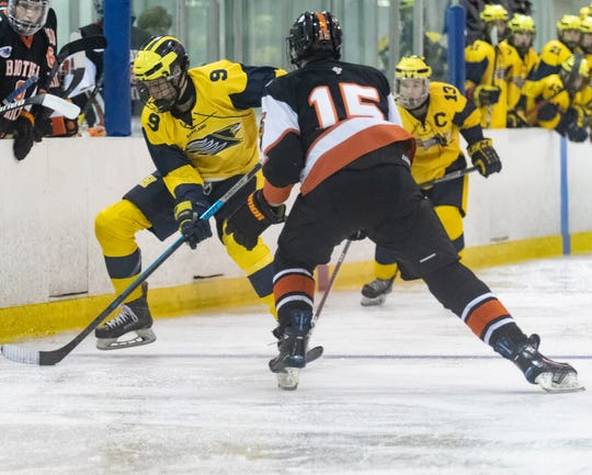 Brother Rice defender Nick Dippre gets in the path of a Hartland forward.