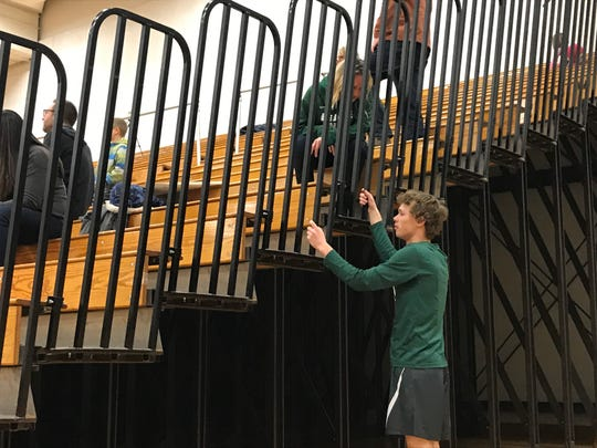 Novi junior guard Bryce Lubin speaks to his mother, Jenny Lubin, before the game against Troy.